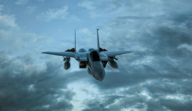 Armed military fighter jet in flight on the cloudly sky background - 3d render Armed military fighter jet in flight on the cloudly sky background - 3d render. bomber plane stock pictures, royalty-free photos & images