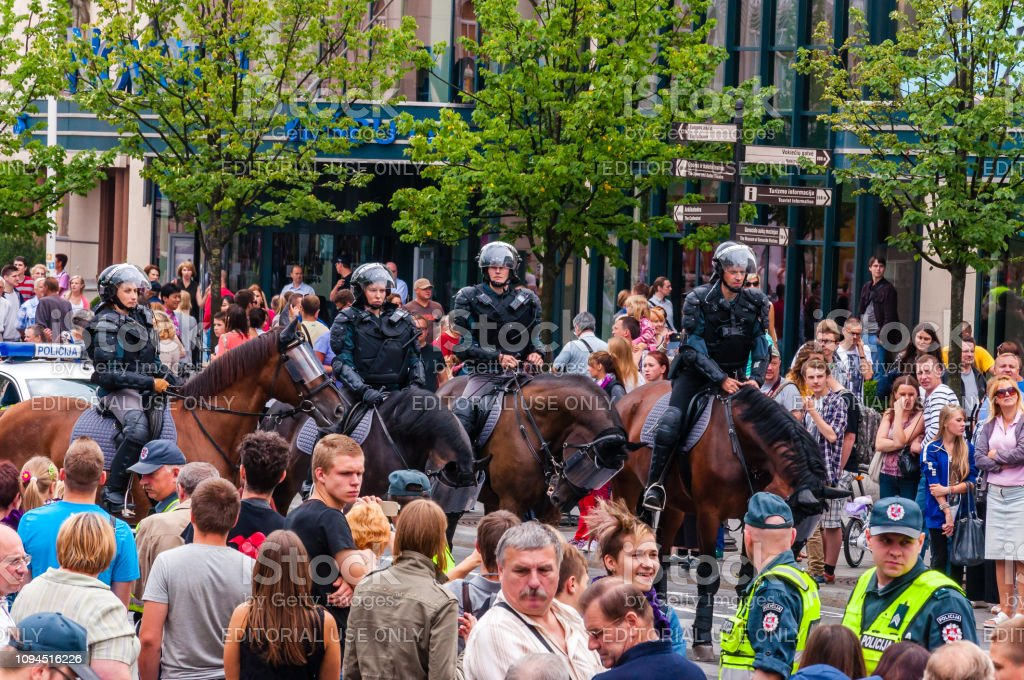 Armed mounted police forces riding at the end of Pride parade on Gedimino street. Event celebrating lesbian, gay, bisexual, transgender, LGBTI culture pride stock photo