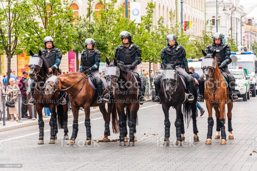 Armed mounted police forces standing at the beginning of Pride parade on Gedimino street. Event celebrating lesbian, gay, bisexual, transgender, LGBTI culture pride stock photo