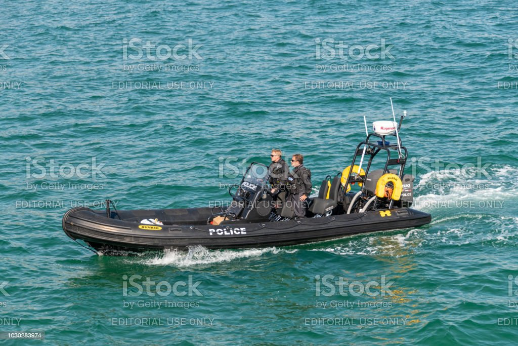 Armed police patrol boat off the coast in Bournemouth stock photo