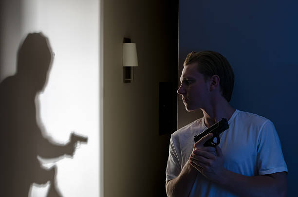 Armed Robber Breaking In Armed resident ready to protect themselves against robber self defense stock pictures, royalty-free photos & images
