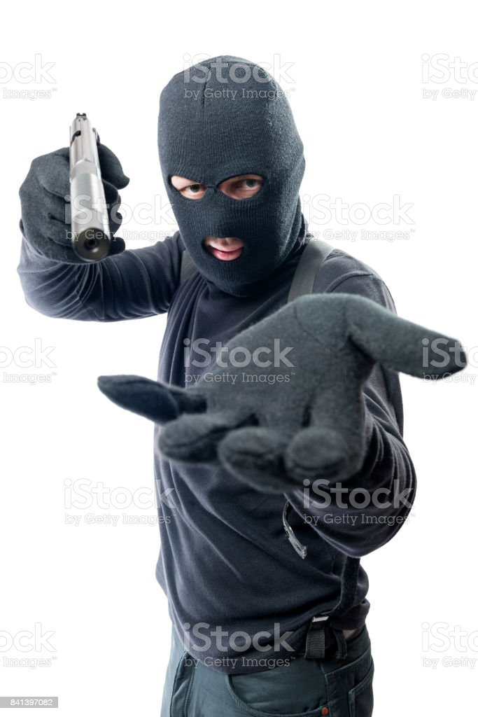 armed-robber-requires-money-and-aims-at-the-camera-picture-id841397082