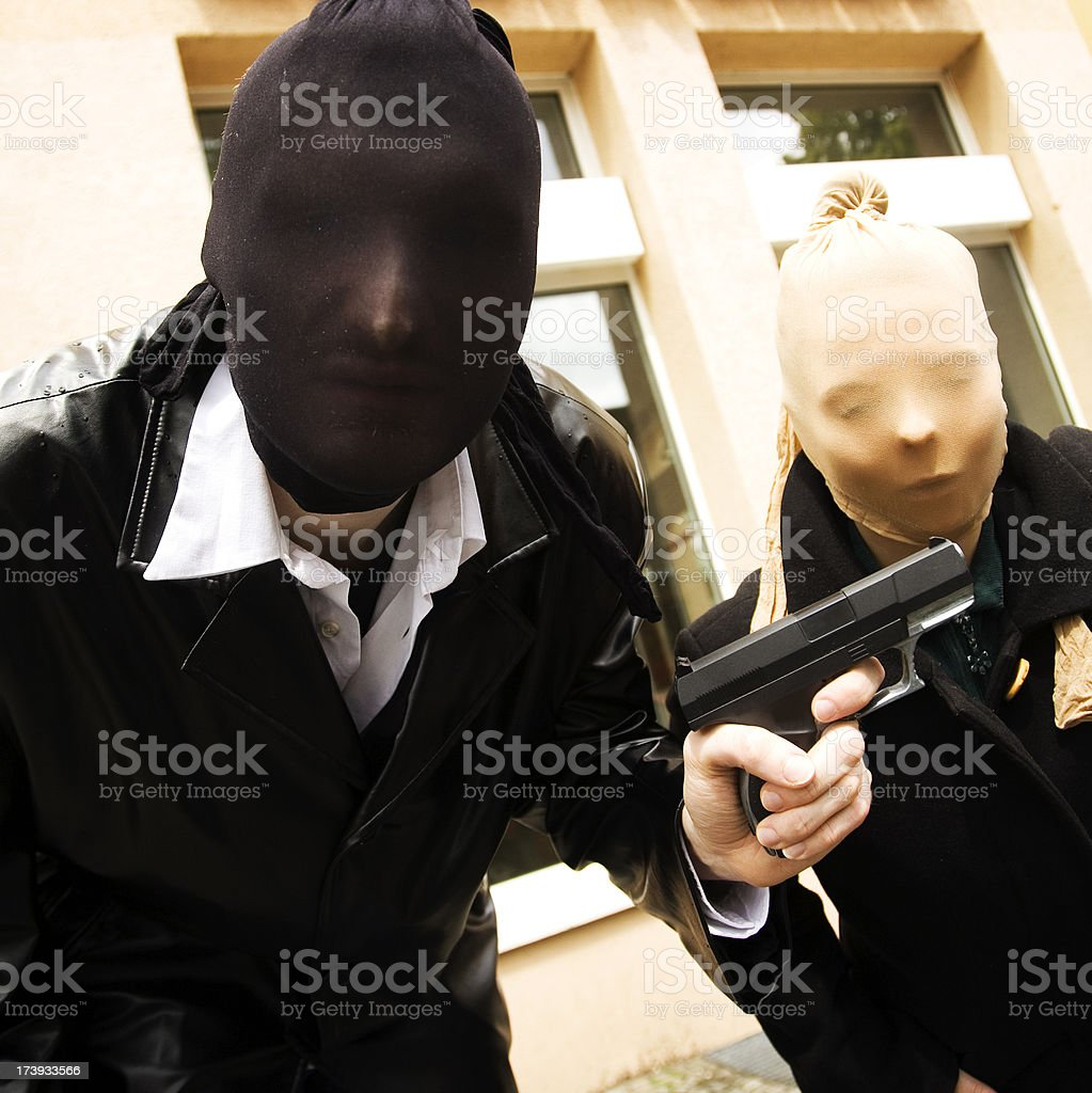 Armed robbers posing for a photo wearing masks stock photo