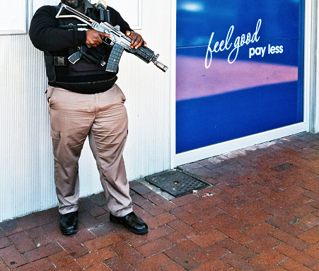 istock Armed security guard at South African ATM 1190558913