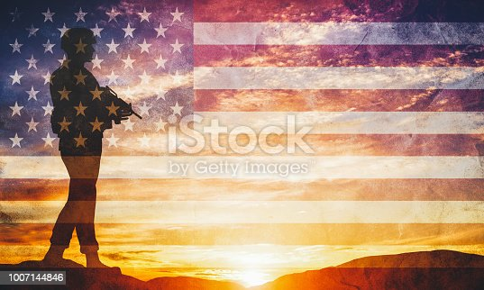 istock Armed soldier with rifle and USA flag. Guard, army, military, war. 1007144846