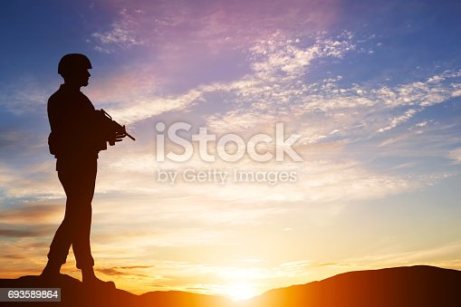 istock Armed soldier with rifle. Guard, army, military, war. 693589864