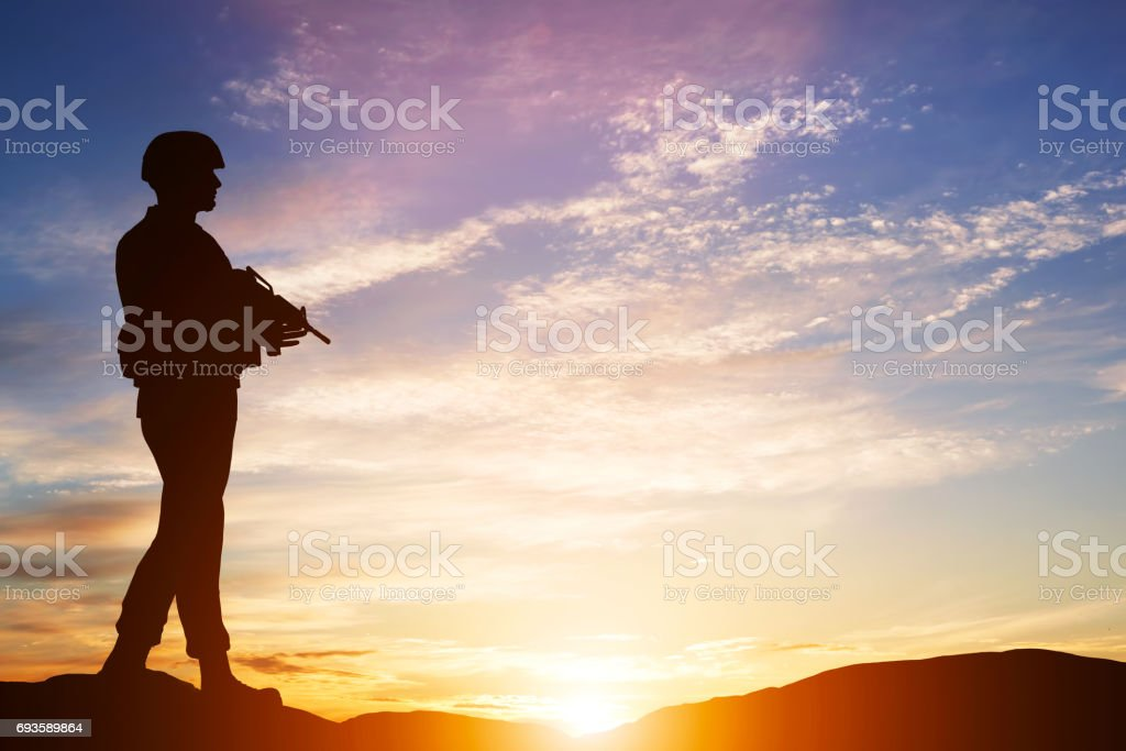 Armed soldier with rifle. Guard, army, military, war. stock photo