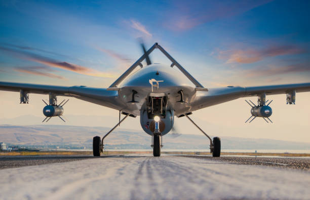 Armed Unmanned Aerial Vehicle on runway Armed Unmanned Aerial Vehicle on runway drone point of view stock pictures, royalty-free photos & images