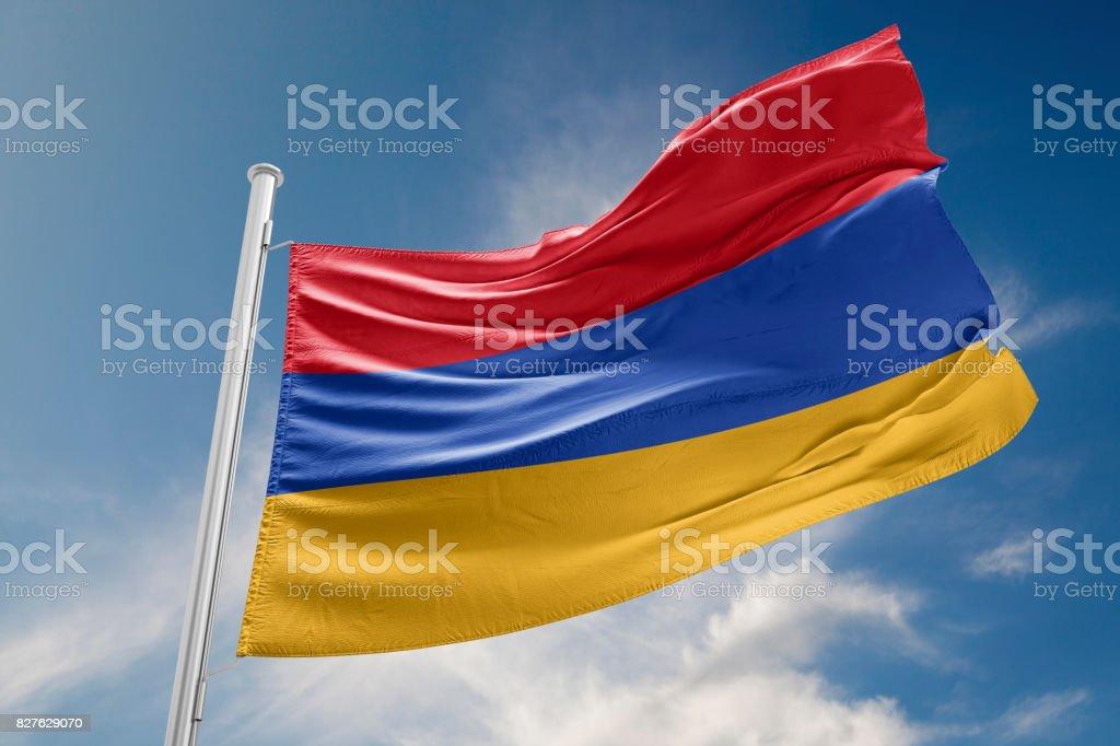 Armenia Flag is Waving Against Blue Sky stock photo