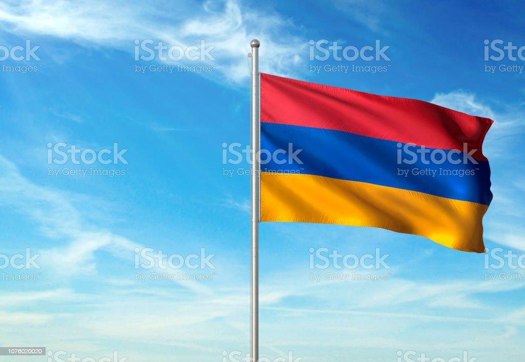 Armenia flag waving cloudy sky background realistic stock photo
