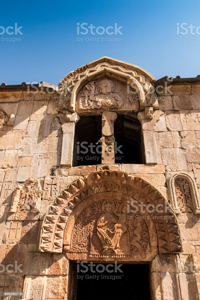 Armenia, the monastery of Noravank. The central entrance to the church of John the Baptist with a unique bas-relief depicting God the Father. stock photo