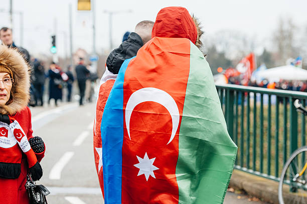 Armenian and Turkey diaspora protesting Strasbourg, France - January 28, 2015: Man wearing Flag of Azerbaijan during a protest in Strasbourg in Front of European Court of Human Rights armenian genocide stock pictures, royalty-free photos & images