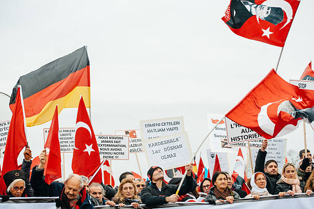 Armenian and Turkey diaspora protesting Strasbourg, France - January 28, 2015: Turkey diaspora demonstrates near European Court of Human Rights before the Perincek vs. Switzerland case begin. Armenian government was represented by Amal Clooney armenian genocide stock pictures, royalty-free photos & images