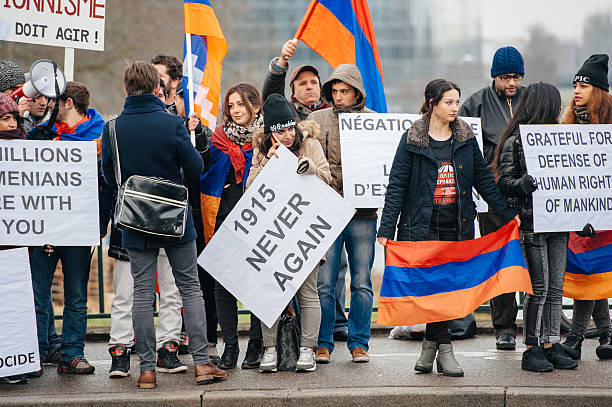 Armenian and Turkey diaspora protesting Strasbourg, France - January 28, 2015: Armenian diaspora demonstrates near European Court of HR before the Perincek vs. Switzerland case begin. Armenian government was represented by Amal Clooney armenian genocide stock pictures, royalty-free photos & images