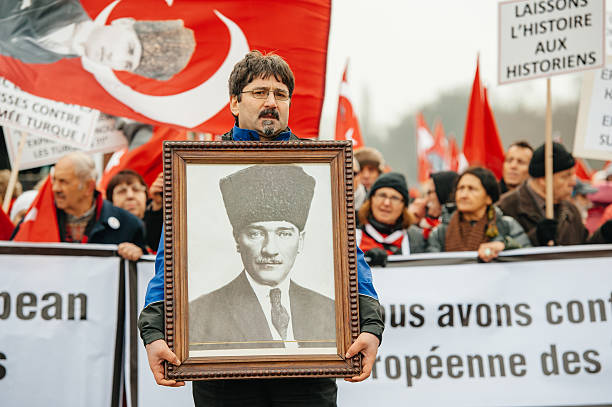 Armenian and Turkey diaspora protesting Strasbourg, France - January 28, 2015: Man holding Ataturk portrait during demonstration near European Court of HR before the Perincek vs. Switzerland case begin. Armenian government was represented by Amal Clooney armenian genocide stock pictures, royalty-free photos & images