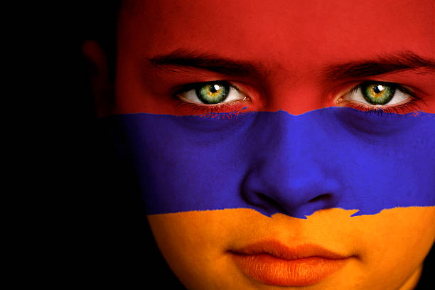 Armenian flag boy Portrait of a boy with the flag of Armenia painted on his face armenian ethnicity stock pictures, royalty-free photos & images