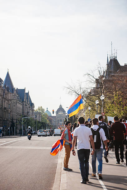 Armenian genocide 100th  rememberance march in France Strasbourg, France - April 24, 2015: Armenian protesters march for 100th remembrance year of Armenian genocide in 1915 as part of 'Armenian Genocide Remembrance Day' armenian genocide stock pictures, royalty-free photos & images