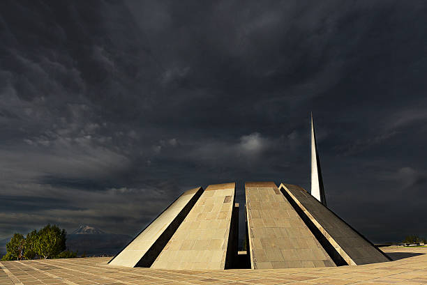 Armenian genocide memorial in Yerevan, Armenia Yerevan, Armenia - September 22, 2016: Armenian genocide memorial monument with dark clouds and Mt Ararat on the background, in Yerevan, Armenia. armenian genocide stock pictures, royalty-free photos & images