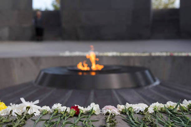 Armenian Genocide Memorial in Yerevan, Armenia Flowers are laid out in a row at the eternal flame at the Armenian Genocide Memorial in Yerevan, Armenia. armenian genocide stock pictures, royalty-free photos & images