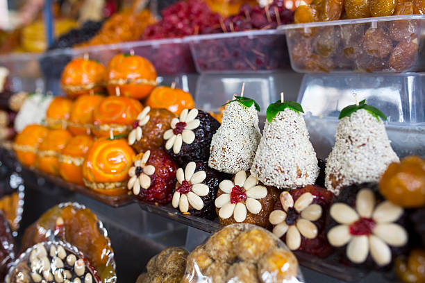 Armenian home made traditional sweets at the market in Yerevan. Armenian home made traditional sweets made from dried fruits for sale at the market in the capital YerevanArmenian home made traditional sweets made from dried fruits for sale at the market in the capital Yerevan yerevan stock pictures, royalty-free photos & images