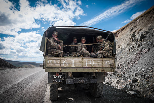 Armenian soldiers leaving Nagorno-Karabakh Sotk Pass, Armenia -September 25, 2016: A truck carrying Armenian soldiers, traveling from Nagorno-Karabakh to Armenia, stops at the top of the 2400-meter Sotk Pass at the border of Armenia and Nagorno-Karabakh. armenian ethnicity stock pictures, royalty-free photos & images