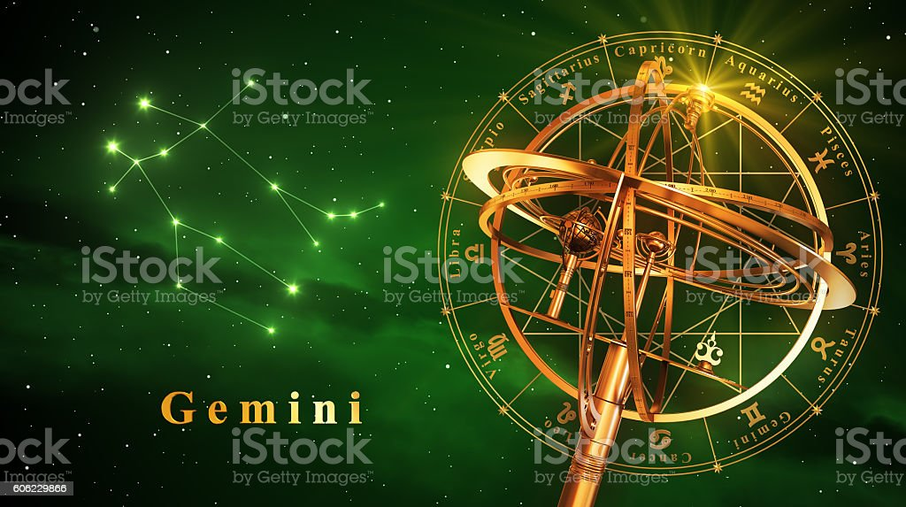 Armillary Sphere And Constellation Gemini Over Green Background stock photo