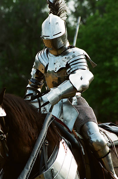 armored knight suited up for battle - knight on horse stock photos and pictures