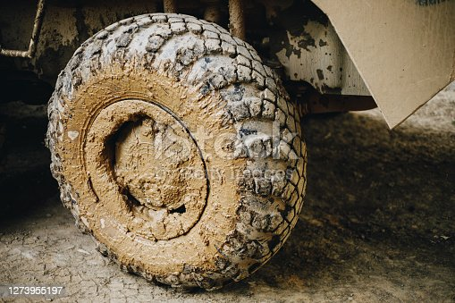 dirty armored personnel carrier wheels close-up. High quality photo