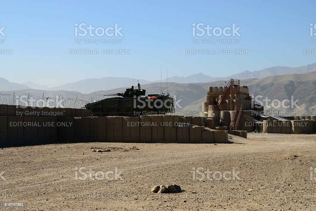 Armored tank at military battlefield stock photo