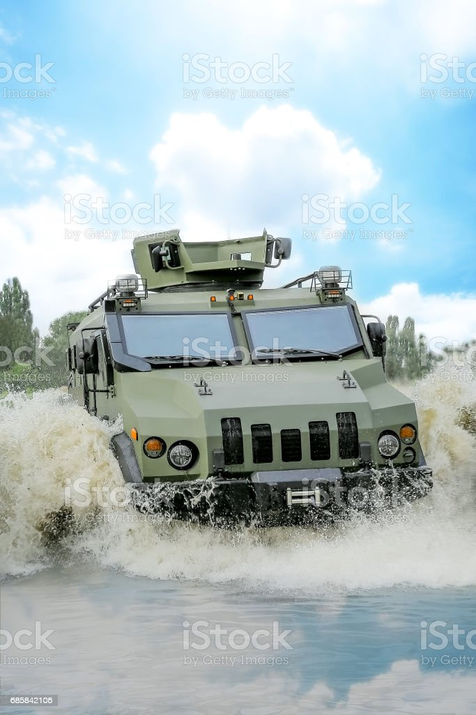armored troop-carrier in water stock photo