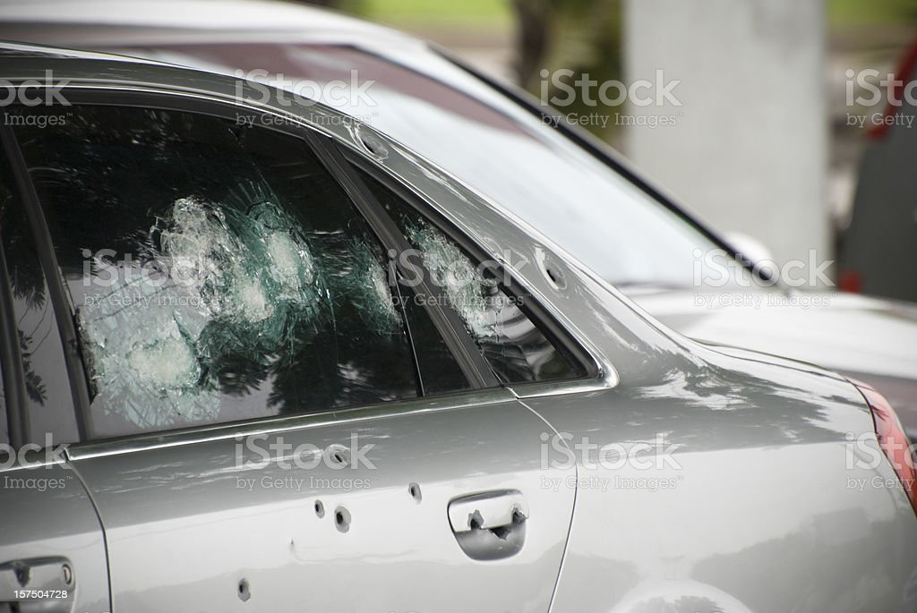 Armoured car with bullet holes, crime and terrorism concept stock photo
