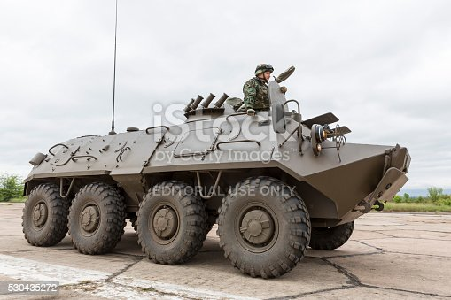 Sofia, Bulgaria - May 4, 2016: Soldiers from the Bulgarian army are preparing for a parade for Army's day. They are testing an army's battle vehicle on a military airport two days before the official celebration.
