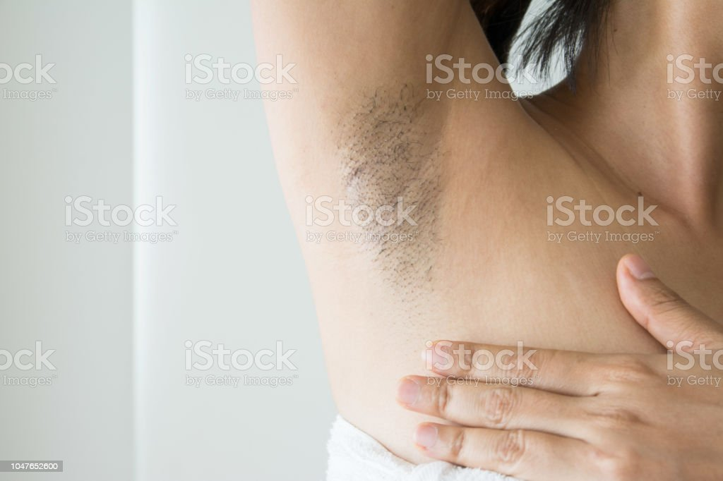 Armpit and armpit hair of Asian women on white background stock photo