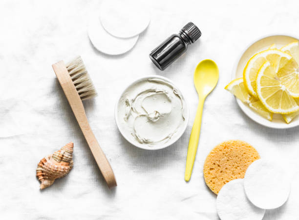 Armpit detox mask with white clay, tea tree essential oil and lemon on a light background, top view Armpit detox mask with white clay, tea tree essential oil and lemon on a light background, top view exocrine gland stock pictures, royalty-free photos & images