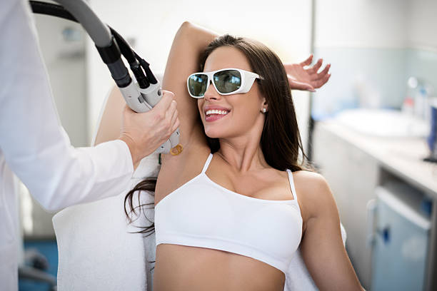 Armpit epilation treatment Young woman is having her armpit hair removed with medical laser procedure. laser stock pictures, royalty-free photos & images