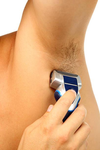 Armpit shaving stock photo