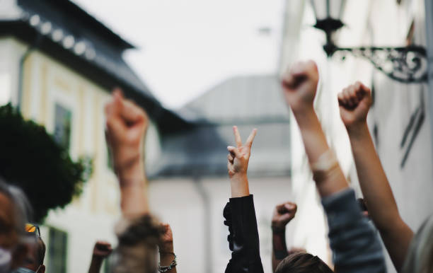 Arms and fists raised in the air, protest and demonstration concept. stock photo