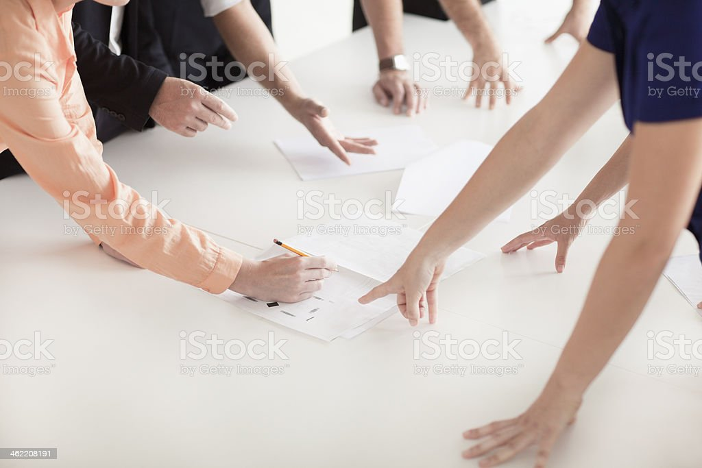 Arms and hands of businesspeople having a business meeting stock photo