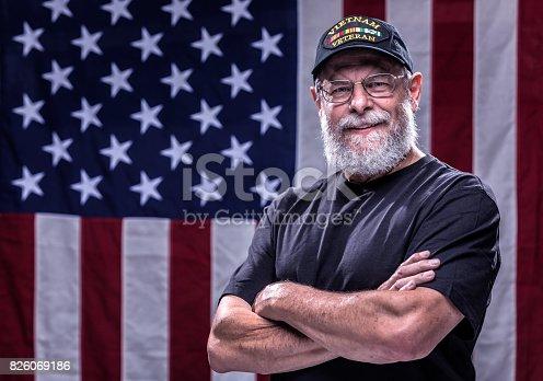 Arms Crossed USA Vietnam Veteran and American Flag