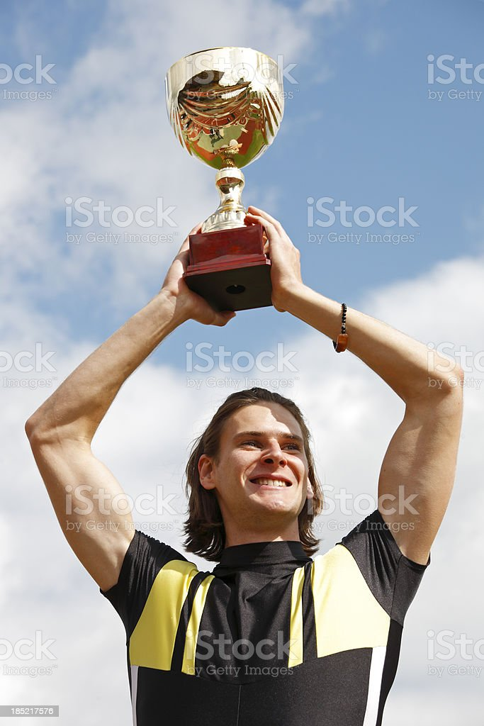 Arms in the air with winning trophy royalty-free stock photo