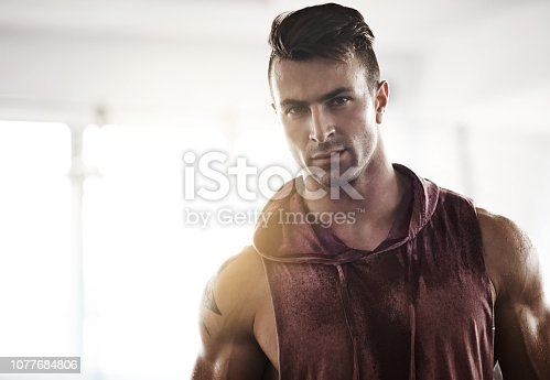 Portrait of a handsome young man at the gym
