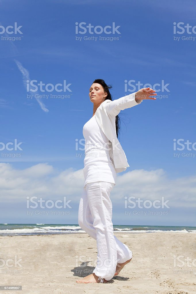 arms outstretched carefree woman royalty-free stock photo