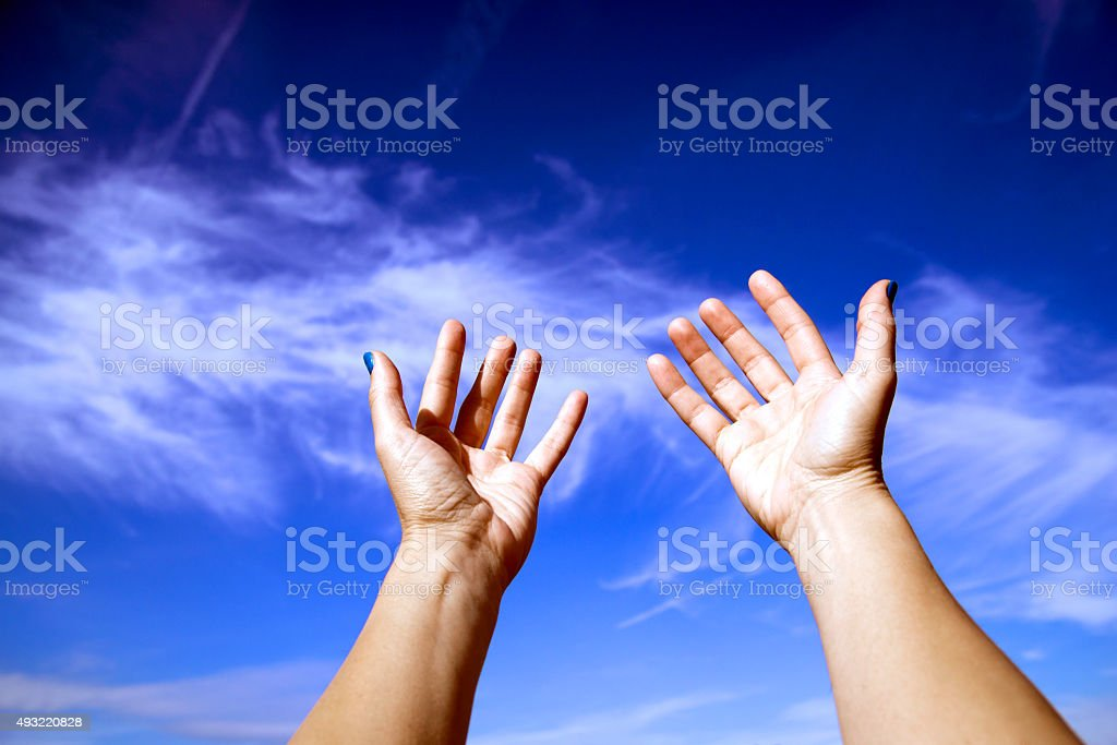 arms stretched out to the sky, Worship stock photo