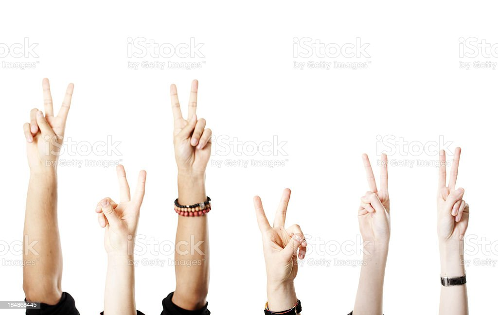 Arms with victory sign stock photo