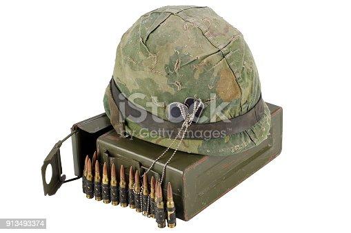 907208642 istock photo US Army Ammo Box with ammunition belt and helmet 913493374