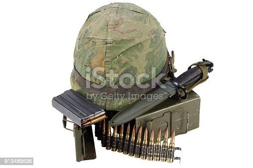 907208642 istock photo US Army Ammo Box with ammunition belt, bayonet and helmet 913489536