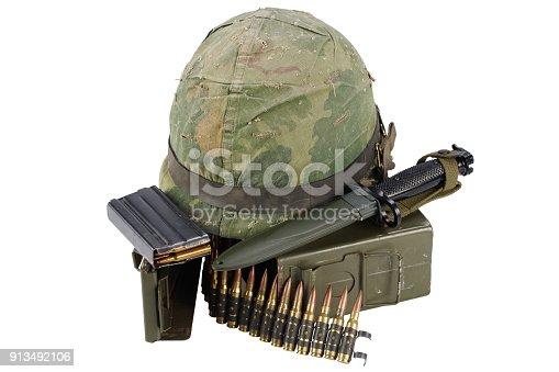 907208642 istock photo US Army Ammo Box with ammunition belt, bayonet and helmet 913492106