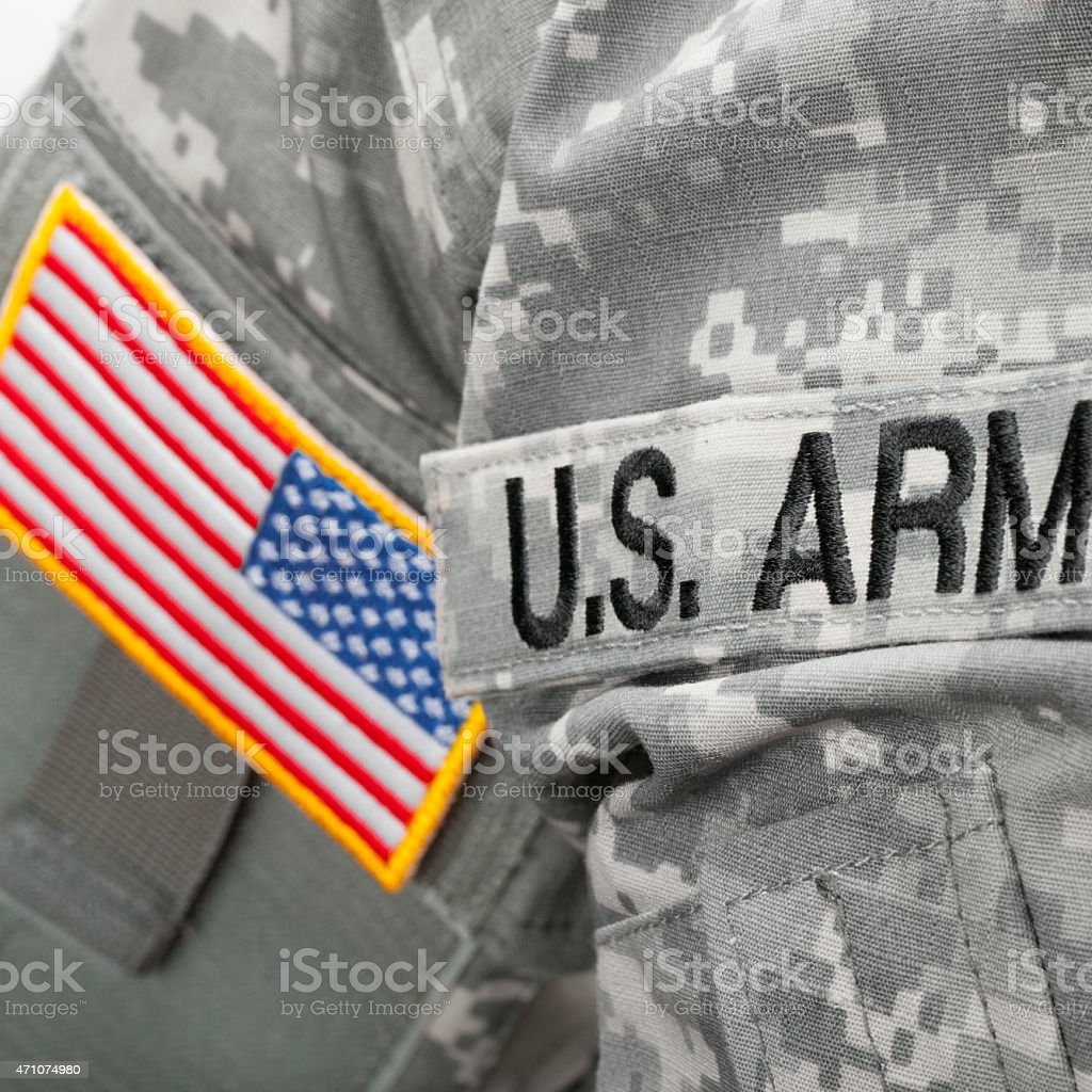 U.S. Army and flag patch on solder's uniform stock photo