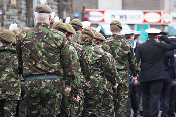 army and navy cadets marching at remembrance day parade - uk military stock photos and pictures