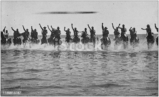 US Army black and white photos: Cavalry charging in the sea